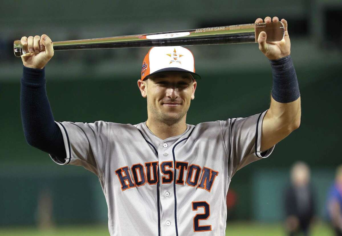 WASHINGTON, DC - JULY 17: Alex Bregman #2 of the Houston Astros and the American League poses with the MVP trophy after defeating the National League during the 89th MLB All-Star Game, presented by Mastercard at Nationals Park on July 17, 2018 in Washington, DC. The American League defeated the National League 8-6.