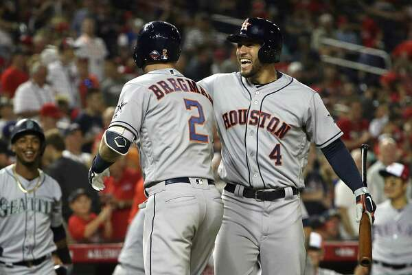 WASHINGTON, DC - JULY 17: Alex Bregman #2 of the Houston Astros and the American League celebrates with George Springer #4 of the Houston Astros and the American League after hitting a solo home run in the tenth inning during the 89th MLB All-Star Game, presented by Mastercard at Nationals Park on July 17, 2018 in Washington, DC.