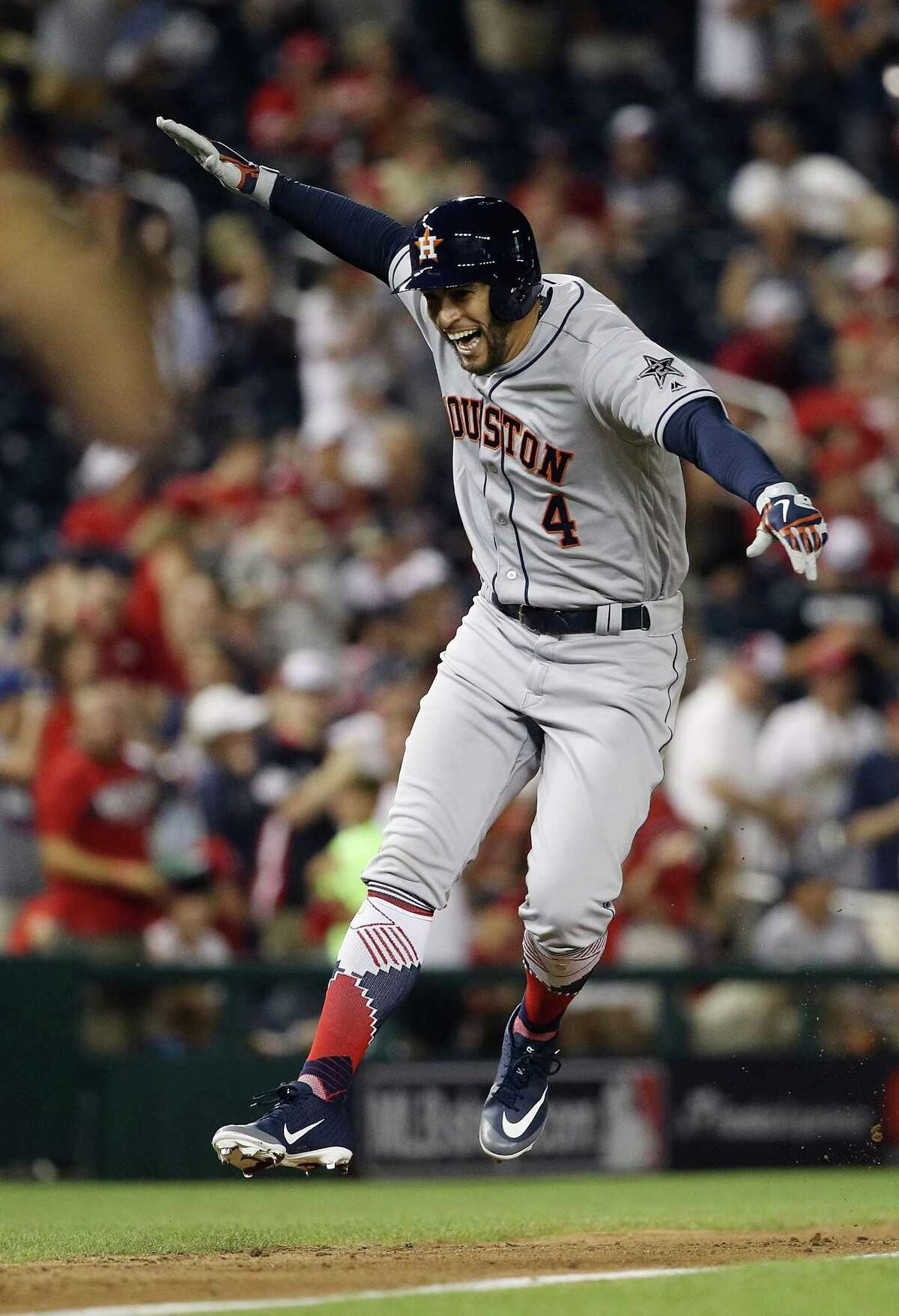 WASHINGTON, DC - JULY 17: George Springer #4 of the Houston Astros and the American League celebrates while rounding the bases after hitting a solo home run in the tenth inning against the National League during the 89th MLB All-Star Game, presented by Mastercard at Nationals Park on July 17, 2018 in Washington, DC.
