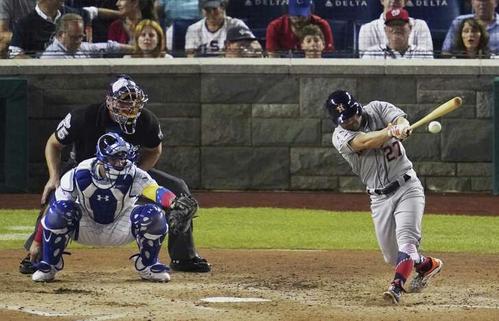 Jose Altuve, whose first-inning strikeout and third-inning popup left him 0-for-10 in All-Star competition, lines a fifth-inning single off the Phillies' Aaron Nola on Tuesday night at Nationals Park.