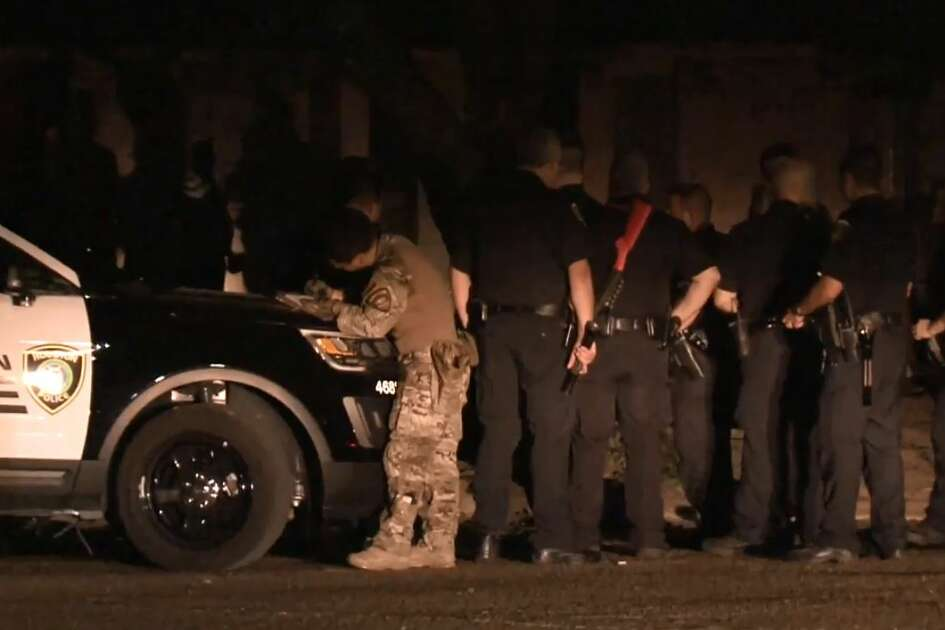 A man was arrested after a Houston SWAT team took him down from a roof on Deirdre, where he was carrying a machete, on Wednesday, July 18, 2018.