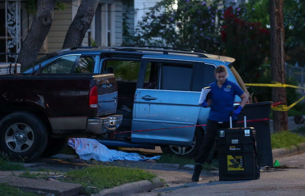 A member of the Houston Forensic Science Center works the scene where a man died on the intersection of Maltby Street and Avenue L, after being shot overnight Wednesday, July 18, 2018, in Houston.