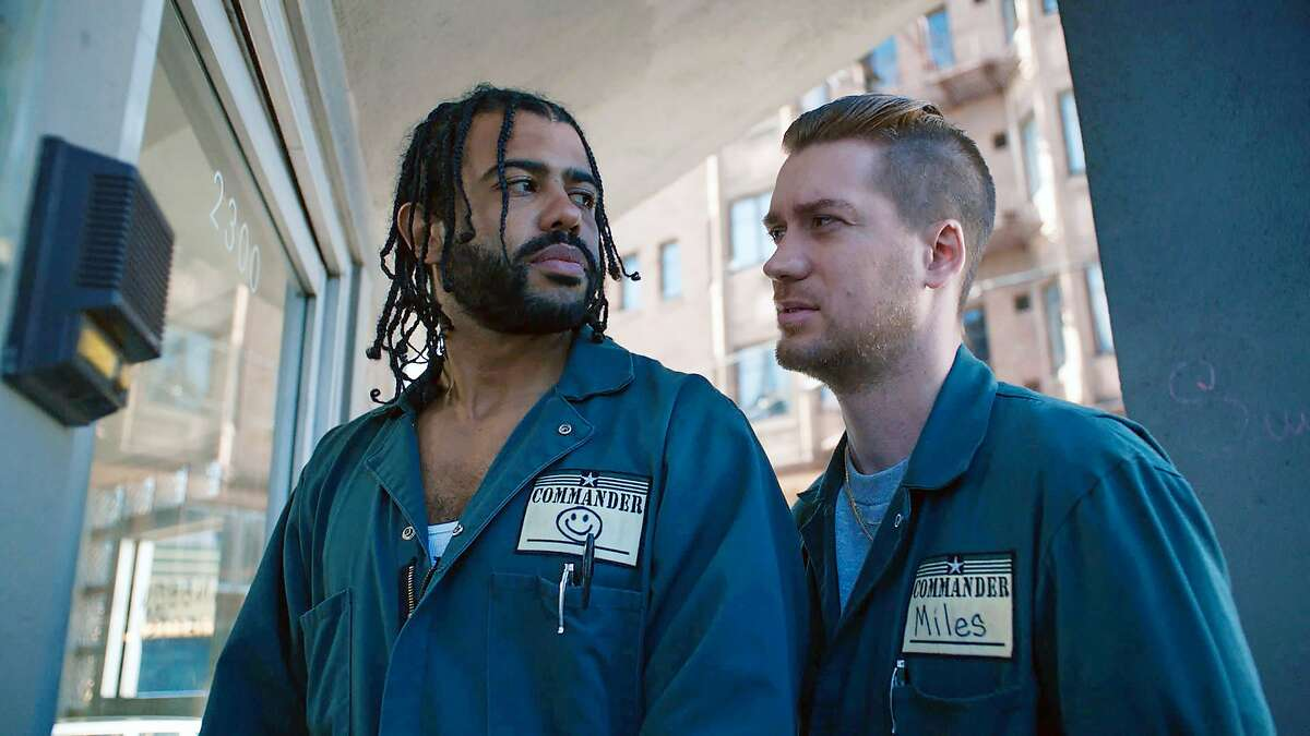 """This image released by Lionsgate shows Daveed Diggs, left, and Rafael Casal in a scene from """"Blindspotting."""" (Ariel Nava/Lionsgate via AP)"""