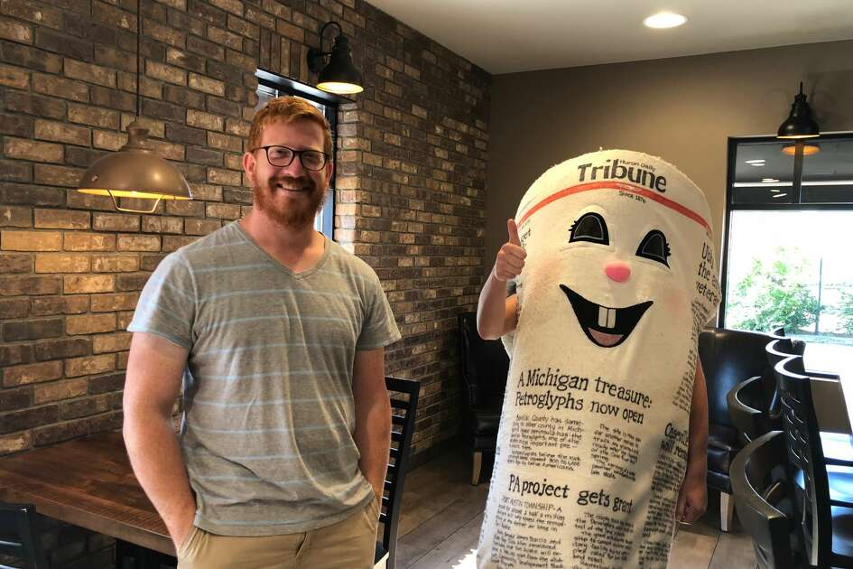 Dale E. Tribune is pictured with Emma's Coffee House Owner Brad Severance.