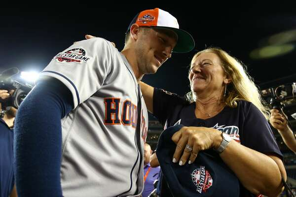 WASHINGTON, D.C. - JULY 17:  Alex Bregman #2 of the Houston Astros celebrates with his mother after winning the Ted Williams Most Valuable Player Award during the 89th MLB All-Star Game at Nationals Park on Tuesday, July 17, 2018 in Washington, D.C. (Photo by Adam Glanzman/MLB Photos via Getty Images)