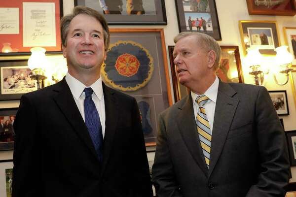 Sen. Lindsey Graham, R-S.C. (right) with Brett Kavanaugh, U.S. Supreme Court associate justice nominee, during a meeting on Capitol Hill in Washington on July 11, 2018.