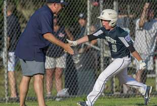 Westport manager Jim Farnen congratulates his son after Jack hit a home run against Fairfield National in the District 2 Little League tournament at Unity Park.