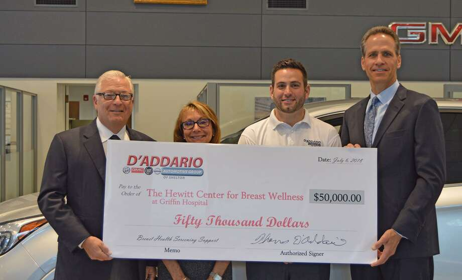 President and CEO Patrick Charmel, right, accepts a donation of $50,000 from Tom DAddario, president, DAddario Automotive Group, far left, Mary DAddario, secretary, and Dan DAddario, vice president and general manager. Photo: Contributed Photo / Christian Meagher - Griffin Hospital