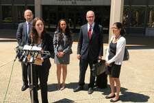 Hannah Schoen, Yale law school intern representing the families of 2 immigrant children from Honduras and El Salvador, addresses the press outside the federal courthouse in Bridgeport, Conn. on Wednesday, July 18, 2018.