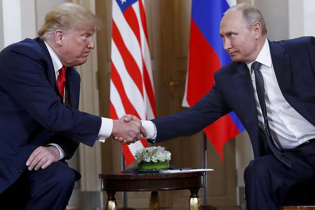 FILE - In this July 16, 2018, file photo, U.S. President Donald Trump, left, and Russian President Vladimir Putin shake hands at the beginning of a meeting at the Presidential Palace in Helsinki, Finland. If Donald Trump is serious about his public courtship of Vladimir Putin, he may want to take pointers from one of the Russian leader's longtime suitors: Chinese President Xi Jinping. In this political love triangle, Putin and Xi are tied by strategic need and a rare dose of personal affection, while Trump's effusive display in Helsinki showed him as an earnest admirer of the man leading a country long considered America's adversary. (AP Photo/Pablo Martinez Monsivais, File)