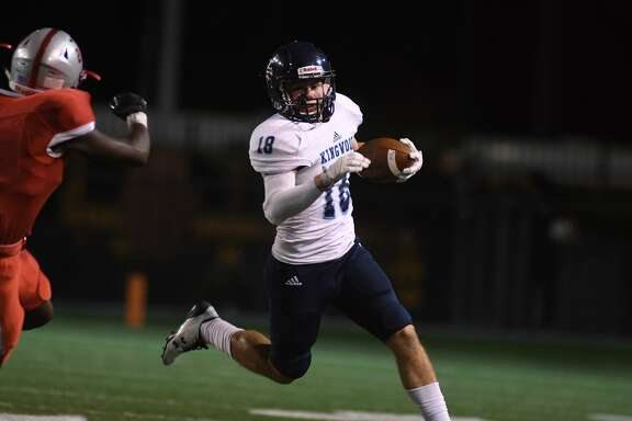 Kingwood junior tailback Carter Amarantos (18) carries the ball around left end against South Houston during first quarter action of their opening round playoff game at Pasadena Veteran's Memorial Stadium in Pasadena on Nov. 17, 2017. (Photo by Jerry Baker/Freelance)