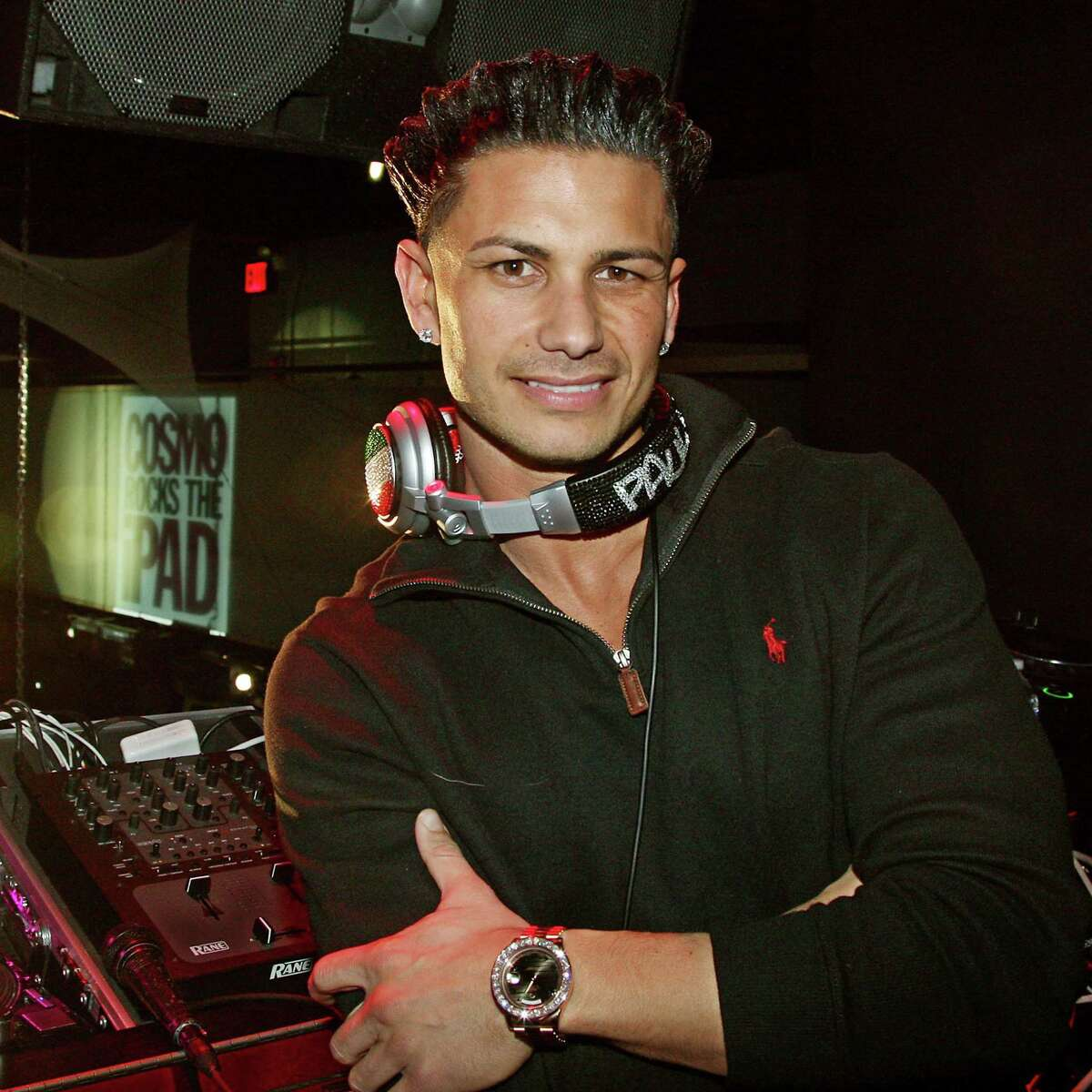 """In this photo released by StarPix, Paul Delvecchio, who is ?""""Pauly D,?"""" on MTV?'s ?""""Jersey Shore,?"""" takes a break from his disc jockey duty to pose for a photo at a party for the new Cosmopolitan magazine iPad app, Wednesday, March, 23, 2011 in New York. Delvecchio is the spokesperson for the app launch. (AP Photo/Starpix, Amanda Schwab)"""