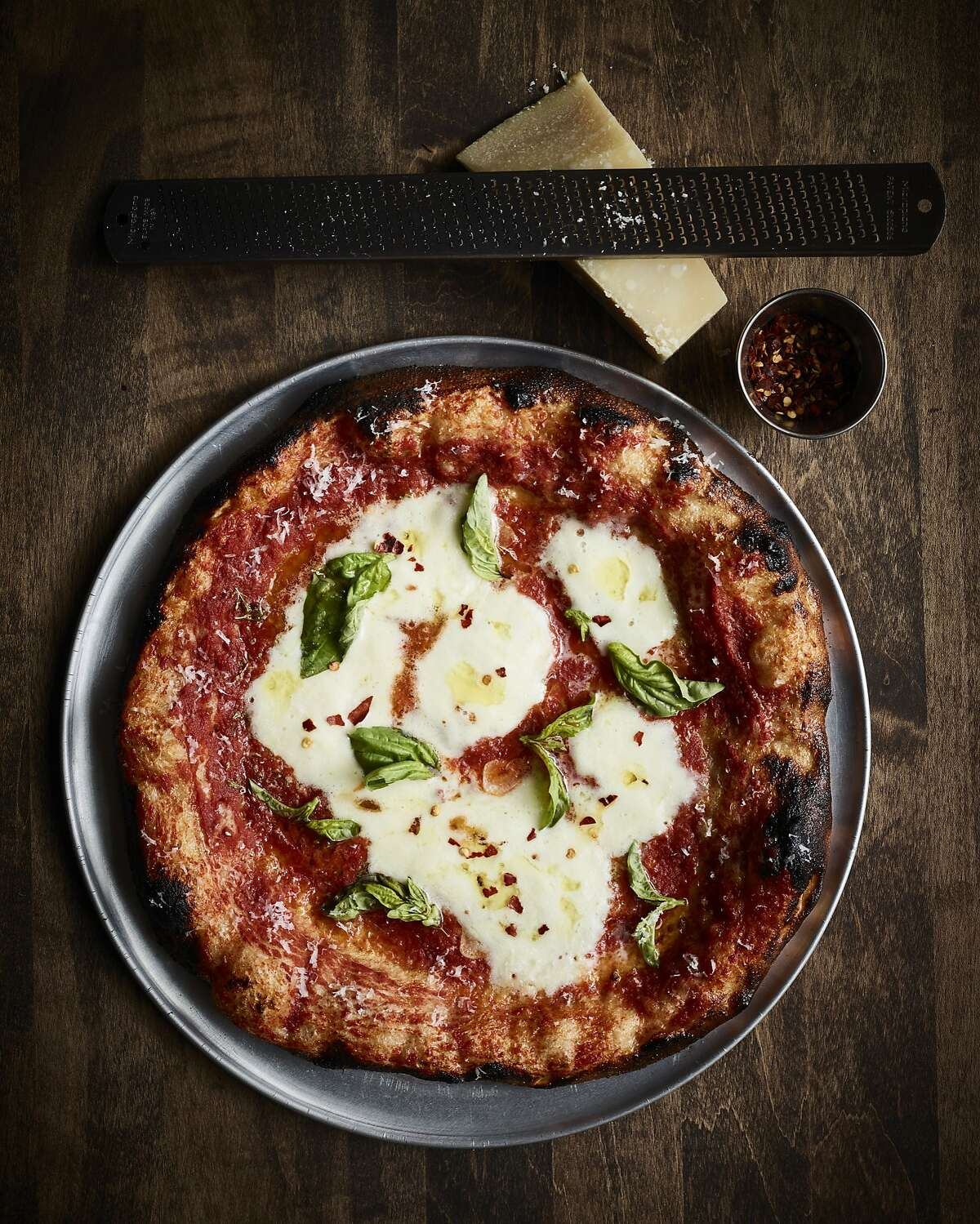 Che Fico's chef, David Nayfeld, became a certified pizzaiolo in Naples, and makes a sourdough crust that is blackened around the edges on purpose.