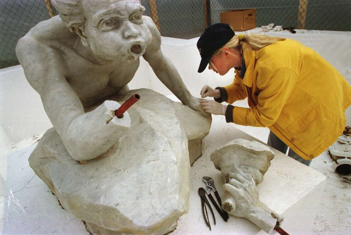Times Union Staff Photograph by Paul Buckowski -- Ane Georgiades, with Matthew Hanlon Restorations out of New York City, starts the repair process on Spit, on Monday October 25, 1999. The two statues, Spit and Spat were damaged at Congress Park in Saratoga Springs, NY. The restoration on the Belgium marble statues started on Monday and according to Matthew Hanlon owner of Hanlon Restorations, he is looking to be done in a week to a week and a half.
