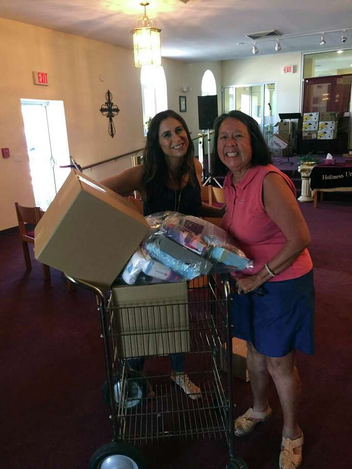 Mamie Lee, right, an Undies Project board member, delivers Undie Sunday donations to Melissa Shapiro at the Salvation Army in Stamford. Photo: Contributed Photo