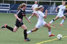 Wilton's Piper Chase, right, pushes the ball up field in front of Fairfield Warde's Lauren Tangney during a game in September. Kristine Lilly Field will be closed beginning on Friday, July 20, as it undergoes a $700,000 project to replace the crumb rubber turf with a coconut husk infill with shock padding.