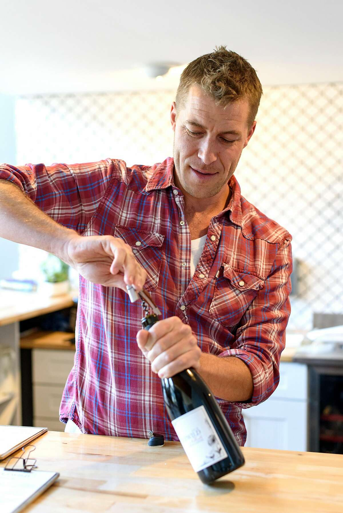 Owner Sam Bilbro opens a bottle of the 2014 Nebbiolo at Idlewild Wines tasting room in Healdsburg, Calif., on Friday June 29, 2018.