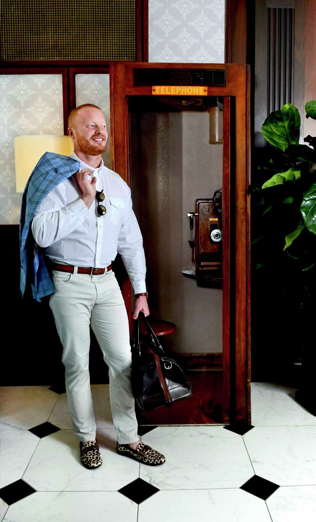 Danilo Stewart poses during a fashion shoot at The Adelphi in Saratoga Springs, N.Y., on Tuesday, June 19, 2018. Clothing and accessories from The National in Saratoga Springs. National custom label sport coat; a Forrest Lennard shirt; Bugatchi Uomo chinos; Martin Dingman shoes, belt and duffel; Peter Millar sunglasses; and a Daniel Wellington watch. (Photo by Colleen Ingerto / Times Union)