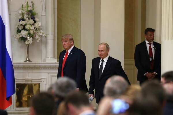 President Donald Trump, left, and Russian President Vladimir Putin, center, seen on Monday, had a two-hour, one-on-one meeting that left the public with only hints of what the two leaders discussed.