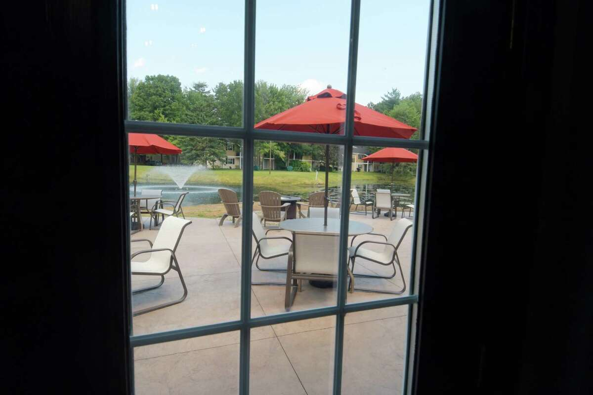 A view looking out onto the new patio at the Twin Lakes Apartments on Wednesday, July 18, 2018, in Clifton Park, N.Y. Officials held an event on Wednesday to mark the completion of the $10 Million Twin Lakes multi-family community renovation and improvement project. The Solomon Organization which owns Twin Lakes, also owns and manages apartment units in Albany, Troy, Mechanicville, Malta and Saratoga Springs. (Paul Buckowski/Times Union)
