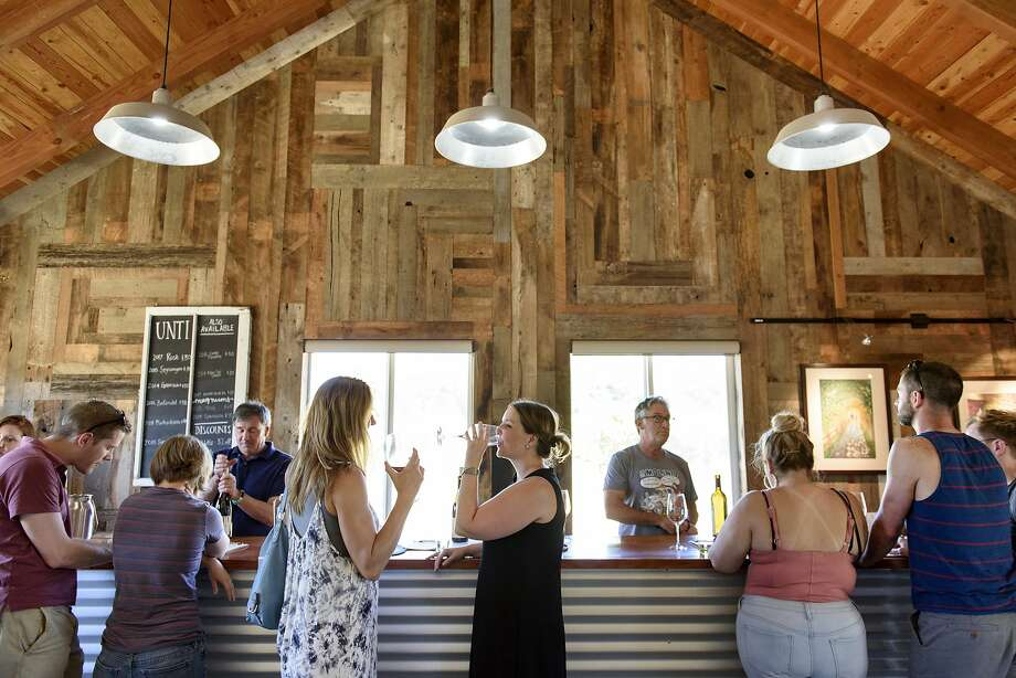 Guests stand at the bar inside Unti Vineyards' tasting room in Healdsburg, Calif., on Saturday June 30, 2018. Photo: Michael Short / Special To The Chronicle 2018