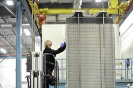 Janet Hixson completes the work on a 400 cell fuel cell stack at the FuelCell Energy manufacturing plant in Torrington, Conn. Wednesday, February 1, 2017.