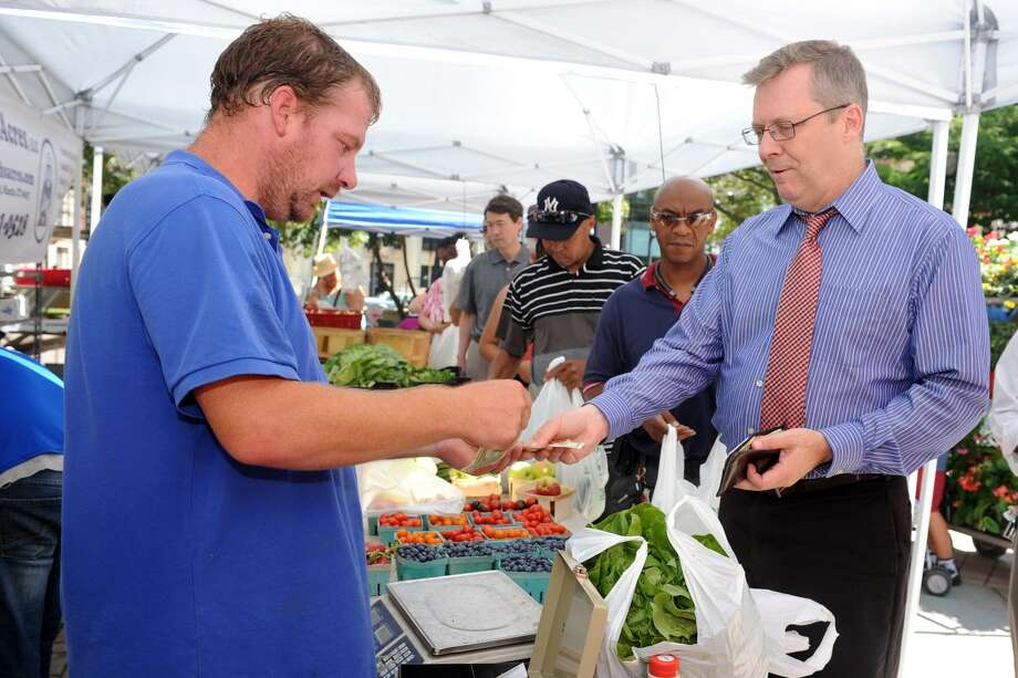 The weekly Farmer's Market held in McLevy Square, in Bridgeport, Conn. Aug. 11, 2016. The market is open every Thursday afternoon. Photo: Ned Gerard / Hearst Connecticut Media / Connecticut Post