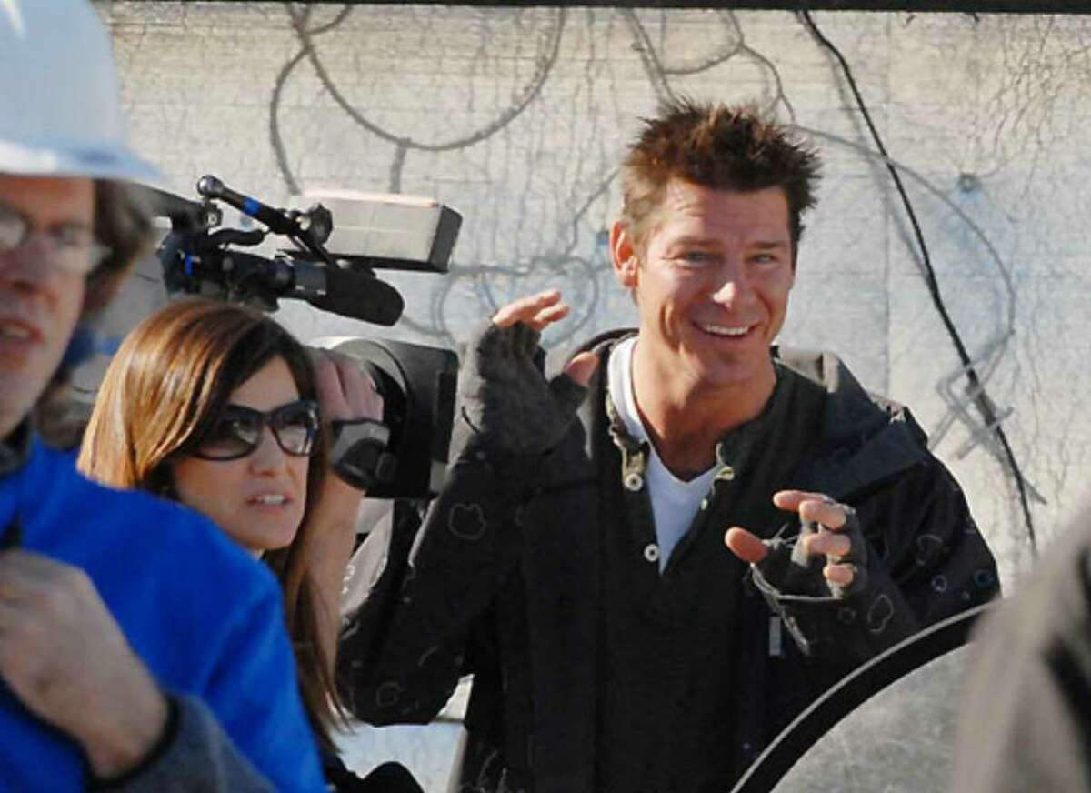 Host Ty Pennington tapes a segment on Saturday before the demolition of Debbie Oatman's home on Fairway Lane in Colonie.