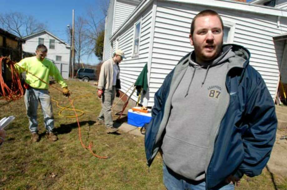 Hudson Valley student Bill Noble gets help from volunteers to fix his Troy home's sewage system, which almost forced the family to move out. Photo: Cindy Schultz