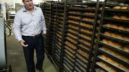 Bill Miller Bar-B-Q CEO Jim Guy Egbert inspects bakery cooling racksat the Bill Miller commissary in Downtown San Antonio.