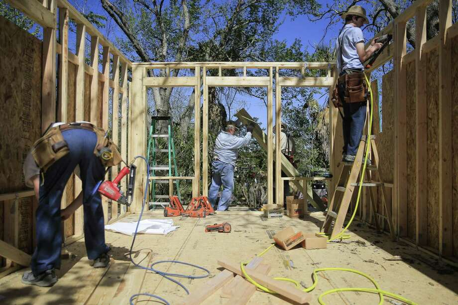 Houston Hero Tommy Overstreet helps build a home for a victim of Hurricane Harvey Tuesday, March 20, 2018 in Rosharon. (Michael Ciaglo / Houston Chronicle) Photo: Michael Ciaglo, Staff Photographer / Houston Chronicle / Michael Ciaglo