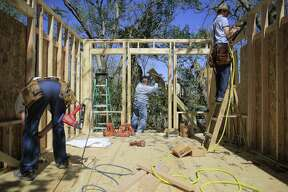 Houston Hero Tommy Overstreet helps build a home for a victim of Hurricane Harvey Tuesday, March 20, 2018 in Rosharon. (Michael Ciaglo / Houston Chronicle)