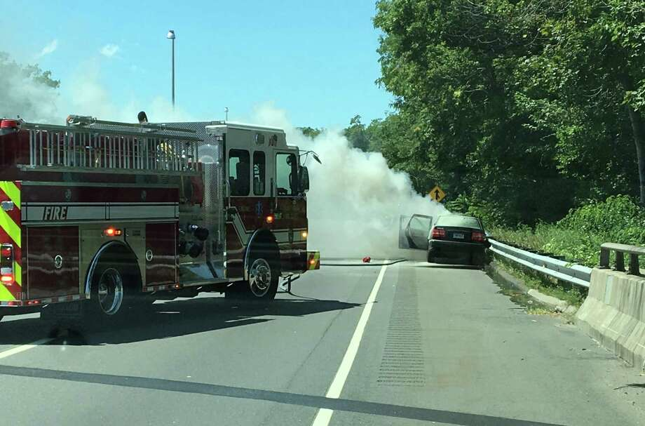 Two witnesses pulled the semi-conscious driver from this car as it was filling with smoke after an accident Wednesday on Interstate 95. Photo: Contributed Photo / Fairfield Citizen