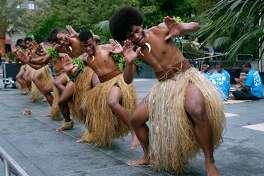 "Jope Kalou (right) and other Fijian dancers perform a ""meke"" dance at Union Square in San Francisco, Calif. on Tuesday, July 17, 2018. The performances by the Kabu ni Vanua dancers are ahead of the Fiji rugby seven team's appearance in the Rugby World Cup Sevens tournament this weekend at AT&T Park."