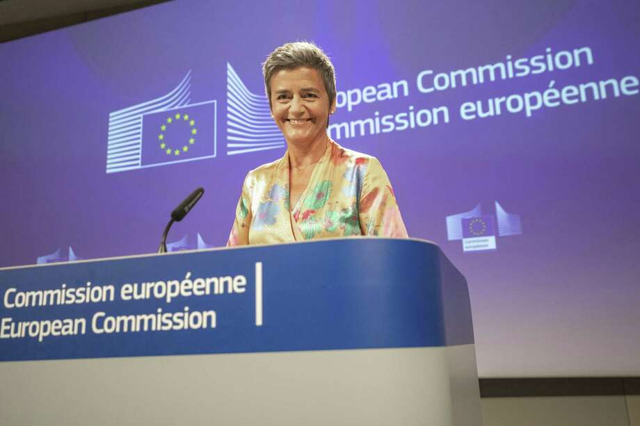 EU Commissioner Margrethe Vestager smiles during a press conference on a Competition Case involving Google Android at the European Commission building, in Brussels on Wednesday, July 18, 2018. he European Union's antitrust chief has fined Google a record $5 billion for abusing the market dominance of its Android mobile phone operating system. Photo: Olivier Matthys /Associated Press / Copyright 2018 The Associated Press. All rights reserved.