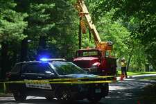 Wilton Police and Eversource employees investigate a workplace accident scene on Rivergate Drive in Wilton that killed 44-year-old Marco Silva of Danbury on June 9, 2016. Silva's widow has filed a lawsuit against Eversource and his employer, KTI Utility Construction & Maintenance LLC.