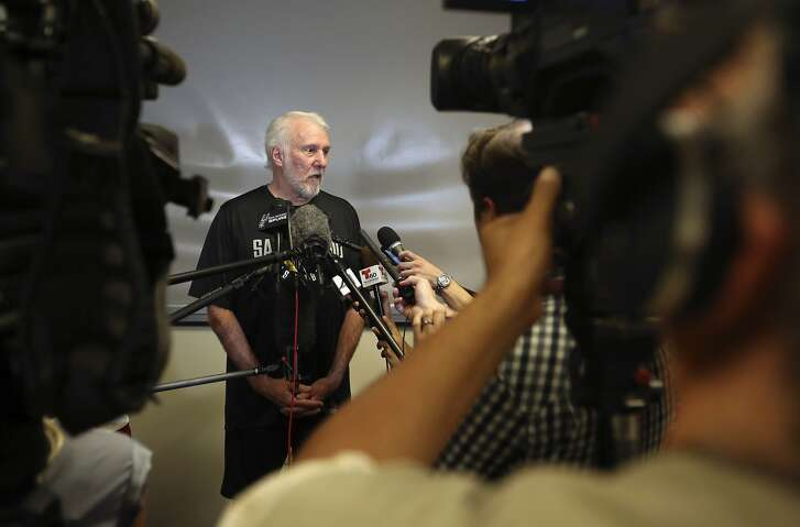 San Antonio Spurs NBA basketball team head coach Gregg Popovich speaks to the media during a press conference in San Antonio, Wednesday, July 18, 2018. The Kawhi Leonard saga in San Antonio is over. So is DeMar DeRozan's time in Toronto.  An NBA summer blockbuster got pulled off Wednesday, July 18, 2018, with the Spurs sending Leonard to the Raptors as part of a four-player deal that has DeRozan heading to San Antonio. The Spurs also got center Jakob Poeltl and a 2019 protected first-round draft pick, while the Raptors acquired sharpshooter Danny Green. (William Luther/The San Antonio Express-News via AP)