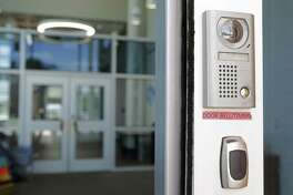 At the main entrance of Matzke Elementary School in the Cypress-Fairbanks district, the exterior security doors lead to the office and interior security doors. ( Melissa Phillip / Houston Chronicle )