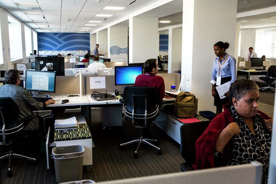 Open office plans were supposed to get people to interact more. One study suggests that workers have found new ways to avoid each other. Photo: Photo By Jeffrey MacMillan For The Washington Post. / The Washington Post