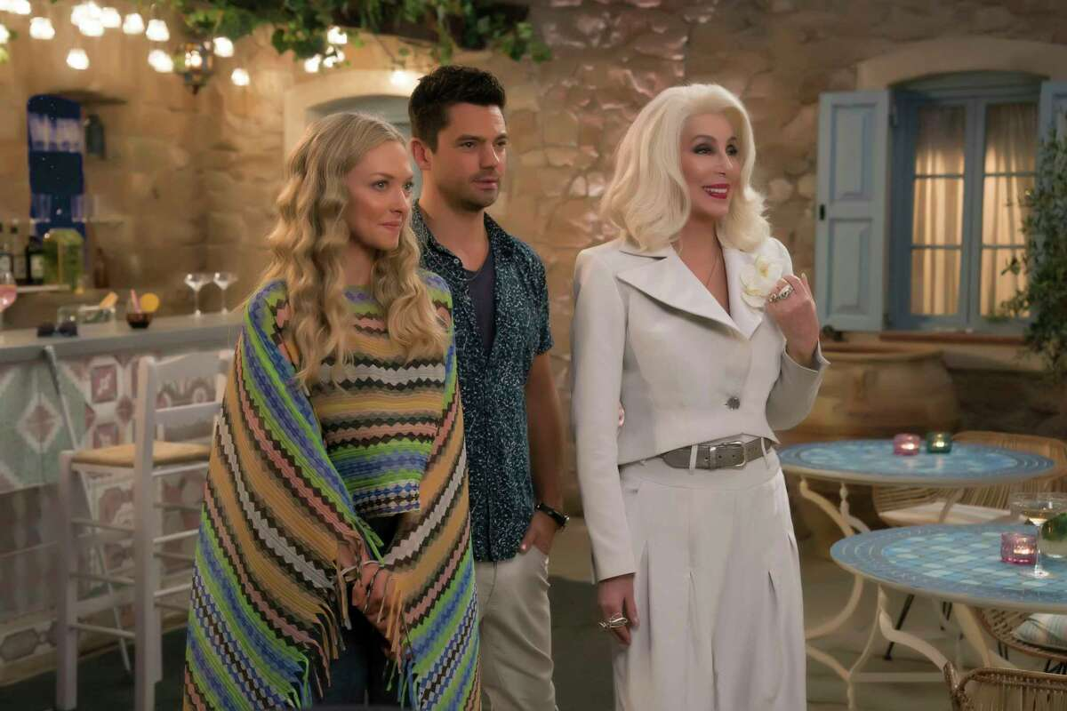 """This image released by Universal Pictures shows Amanda Seyfried, from left, Dominic Cooper and Cher in a scene from """"Mamma Mia! Here We Go Again."""" (Jonathan Prime/Universal Pictures via AP)"""