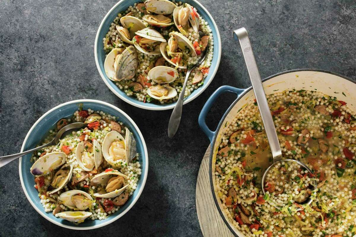 """Clams with pearl couscous, chorizo, and leeks in Brookline, Mass. This recipe appears in the America's Test Kitchen ?""""The Complete Mediterranean Cookbook.?"""" (Steve Klise/America's Test Kitchen via AP)"""