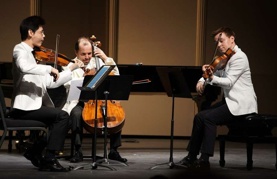 Violinist Angelo Xiang Yu (left), cellist Efe Baltacigil and violist Matthew Lipman perform Françaix's String Trio, which followed intermission at Tuesday's concert. Photo: Geoff Sheil