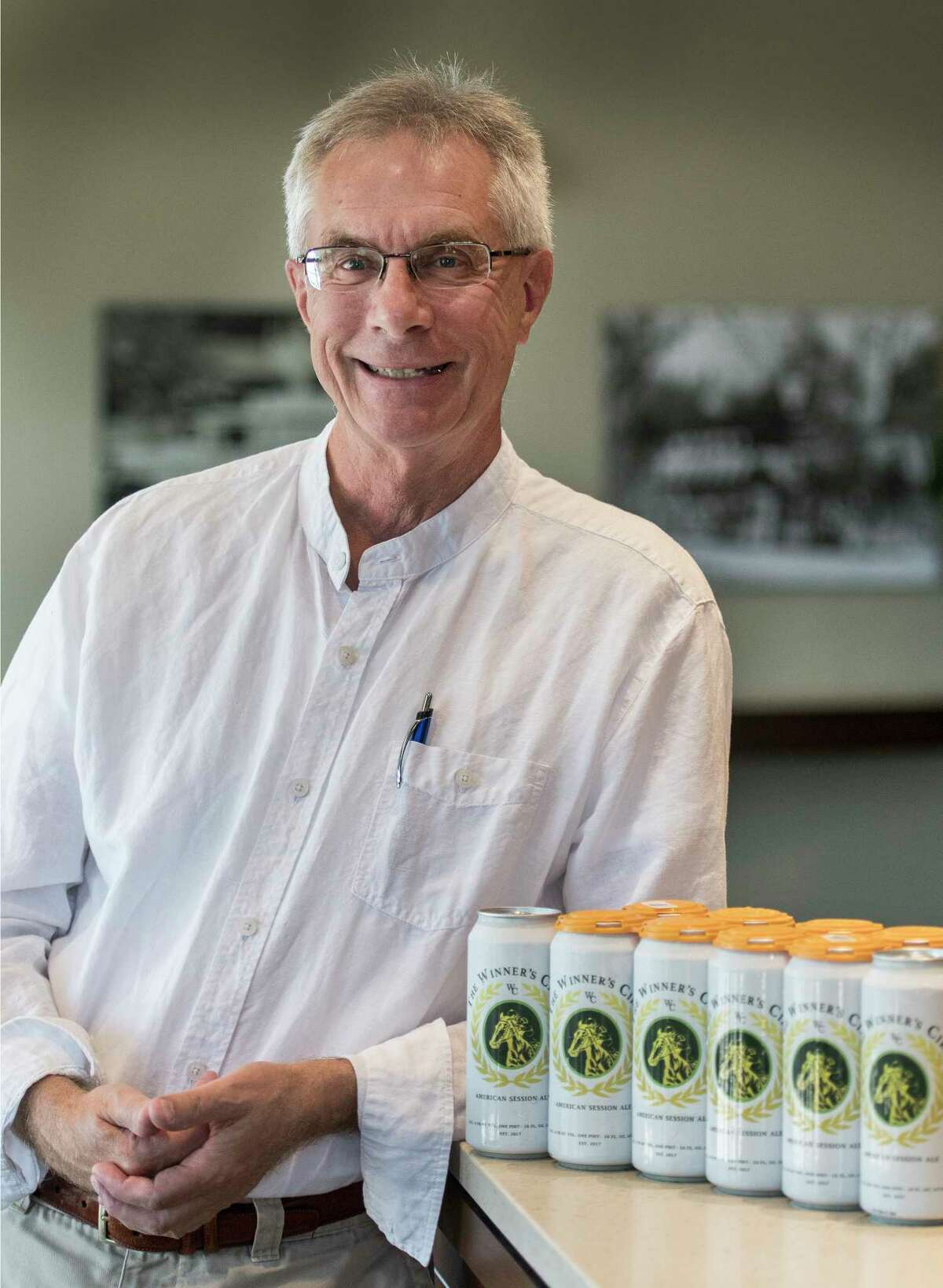 Brewmaster Bill Newman and his new product The Winner's Circle beer at the offices of DeCrescente Distributing Thursday July 12, 2018 in Mechanicville, N.Y. (Skip Dickstein/Times Union)