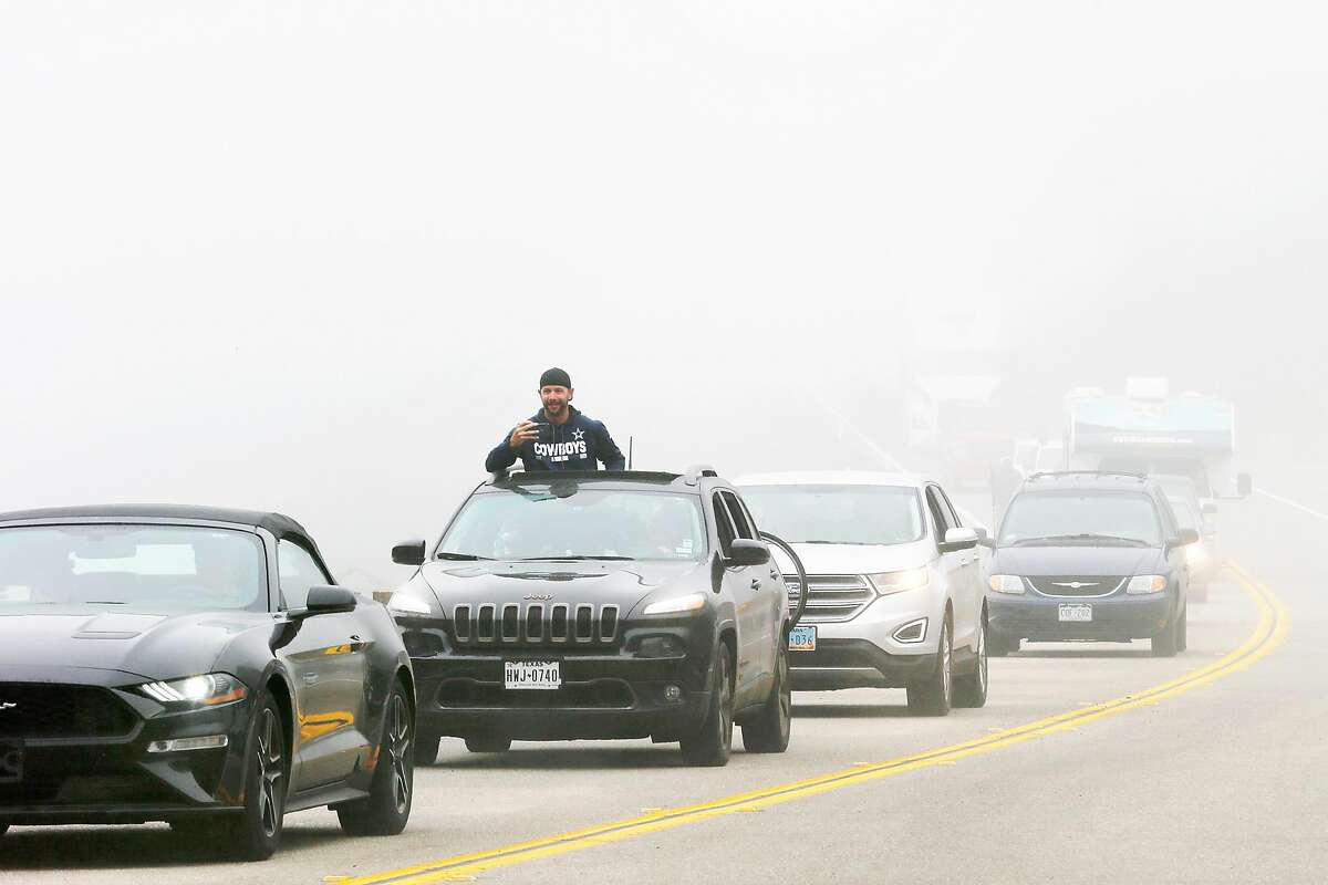 People drive down the new Highway 1 road on Wednesday, July 18, 2018, in Gorda, Calif. The road is open for the first time since last year's Mud Creek slide.