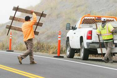 First cars whiz along California's new Highway 1 coastal