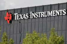 This Monday, Oct. 22, 2012, photo shows corporate signage on the offices of Texas Instruments, in Richardson, Texas. On Tuesday, July 17, 2018, Texas Instruments dumped CEO Brian Crutcher for personal misconduct less than two months after he took over the job, ruining the chip maker's hopes for a smooth transition to new leadership.