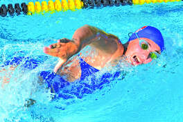 Water Works swimmer Olivia Ramirez competes in a dual meet for the Marlins against Sunset Hills on Tuesday in Edwardsville. Water Works swept the meet to improve to 3-1.
