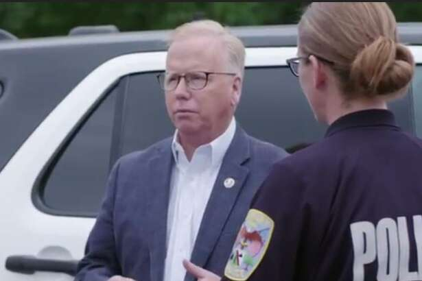 A still from Mayor Mark Boughton's latest campaign commercial shows the Republican candidate for governor with Danbury Police Sgt. Jim Antonelli and Officer Melissa Morril. They were among the five officers named in a federal civil rights lawsuit filed against the department earlier this month.