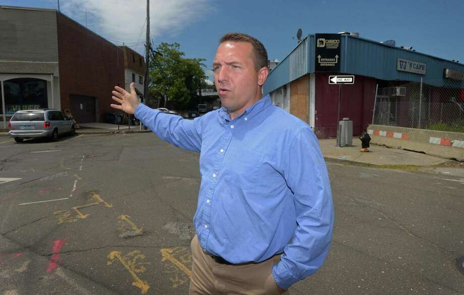 Jason Milligan of Milligan Realty near his newly acquired properties at 21 and 23 Isaac Street Thursday, June 21, 2018, in Norwalk, Conn. The frustrated, decade-long effort to fill in central Wall Street with new apartments, parking and street-level retail got more complicated last week when the city and Norwalk Redevelopment Agency sued the two parties involved in a land transfer involving key parcels within the area of the stalled redevelopment project known as Wall Street Place. Photo: Erik Trautmann / Hearst Connecticut Media / Norwalk Hour