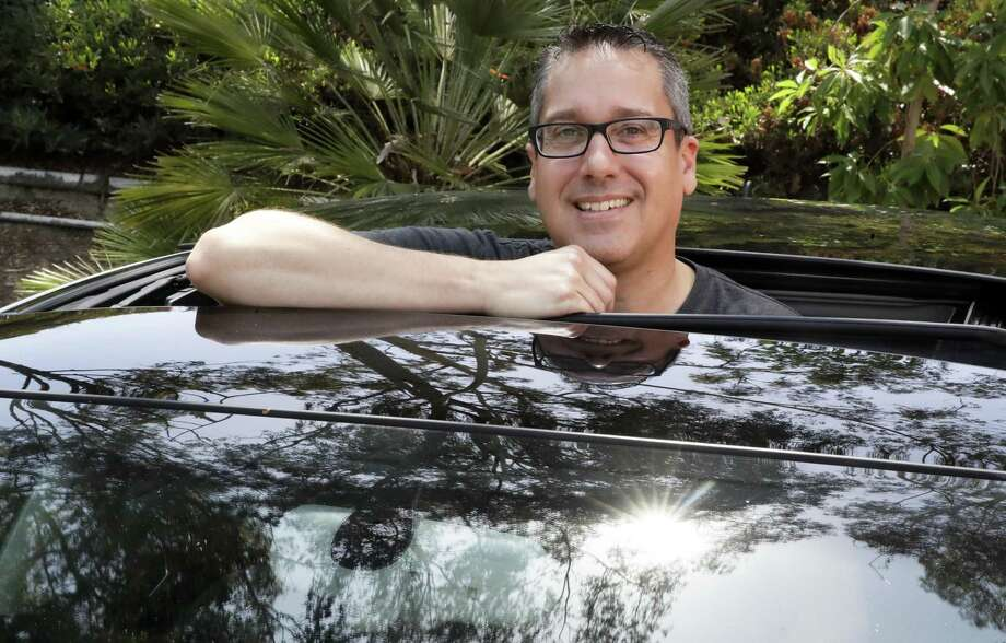 Keith Reynolds, who is on the Tesla waiting list for a Model 3, is photographed by his 9-year-old Audi A3 compact car Monday, July 16, 2018, in Laguna Hills, Calif. For many on the list to buy Tesla's mass-market electric car, the wait for the company to produce enough to satisfy demand isn't a major problem. But the prospect of losing a U.S. federal tax credit is. Photo: Chris Carlson /Associated Press / Copyright 2018 The Associated Press. All rights reserved